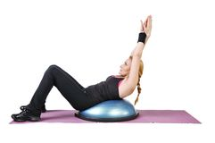 Fit young female pilates instructor Royalty Free Stock Images