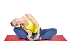 Fit young female yoga instructor showing different Royalty Free Stock Photos