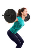 Fit young girl doing squats Royalty Free Stock Images
