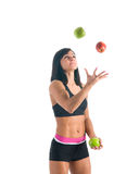 Fit young girl happy about healthy nutrition Royalty Free Stock Images