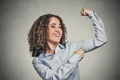 Fit young healthy model woman flexing muscles showing her strength. Closeup portrait beautiful fit young healthy model woman flexing muscles showing her strength Royalty Free Stock Photos