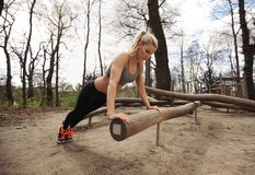 Fit young lady exercising in park Royalty Free Stock Photos