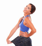 Fit young lady feeling satisfied with waist Stock Image
