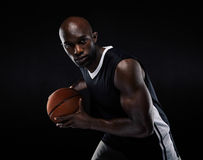 Fit young male athlete playing basketball Royalty Free Stock Images