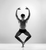 Fit and young male ballet dancer on a grey background Stock Photo