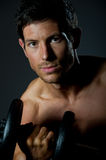 Fit young male with great healthy body and dumbells Stock Photo