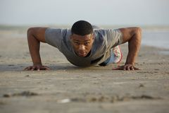 Fit young man doing push ups outdoors Royalty Free Stock Photo
