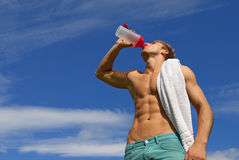 Fit young man drinking water