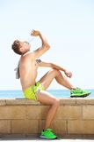 Fit young man drinking water from bottle after workout Royalty Free Stock Image