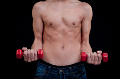 Fit young man exercising with red dumbbell Stock Images