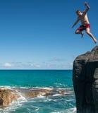 Fit young man jumps into ocean at Lumahai beach Kauai Royalty Free Stock Image
