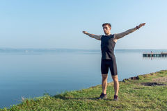 Fit young man preparation for running workout warming up before a run Royalty Free Stock Image