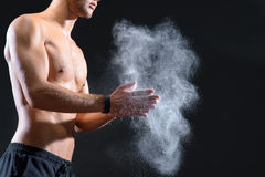 Fit young man rubbing arms with talc Royalty Free Stock Photography