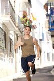 Fit young man running exercise in town Royalty Free Stock Photography