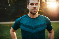 Fit young man in sportswear standing outdoors Stock Photo