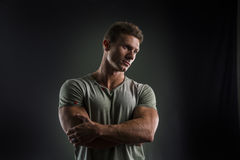 Fit young man standing confident, arms crossed Stock Photography