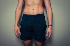 Fit young man with toned stomach Royalty Free Stock Photo