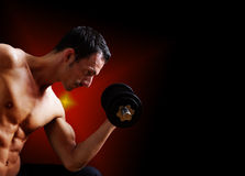 Fit young man working out with dumbbell Stock Image