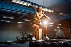 Fit young woman box jumping at a crossfit style. Female athlete is performing jumps at gym stock photos