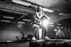 Fit young woman box jumping at a crossfit style. Royalty Free Stock Photo