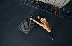 Fit young woman doing crossfit exercise Royalty Free Stock Photo