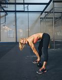 Fit young woman doing crossfit workout Stock Photo