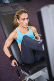 Fit young woman doing leg presses in gym Stock Photo