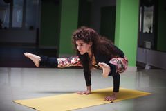 Fit young woman doing yoga  indoor Royalty Free Stock Images