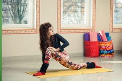 Fit young woman doing yoga  indoor Stock Photo