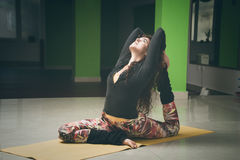 Fit young woman doing yoga  indoor Royalty Free Stock Photos