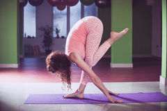 Fit young woman doing yoga  indoor Stock Image