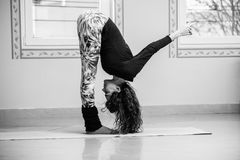Fit young woman doing yoga  indoor Stock Images