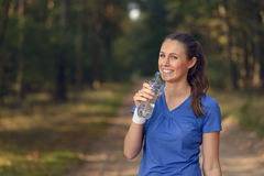 Fit young woman drinking bottled water Royalty Free Stock Image