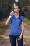 Fit young woman drinking bottled water Stock Image