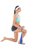 Fit young woman exercising with a blue yoga belt Stock Photo