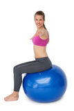 Fit young woman exercising on fitness ball Royalty Free Stock Photo