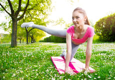 Fit young woman exercising outdoors Stock Images