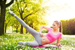 Fit young woman exercising outdoors Royalty Free Stock Image