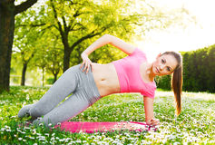 Fit young woman exercising outdoors Royalty Free Stock Photo