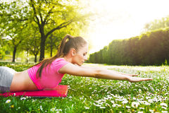 Fit young woman exercising outdoors Stock Photo