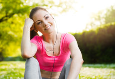 Fit young woman exercising outdoors Royalty Free Stock Photography