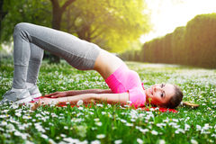 Fit young woman exercising outdoors Stock Image