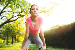 Fit young woman exercising outdoors Royalty Free Stock Photos