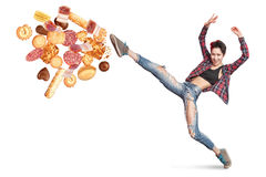 Fit young woman fighting off bad food royalty free stock photo