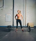 Fit young woman at gym with barbell Royalty Free Stock Photo
