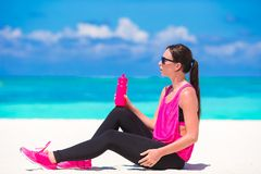 Fit young woman in her sportswear during beach Stock Image