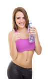 Fit young woman holding bottle of water Royalty Free Stock Photography