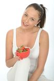 Fit Young Woman Holding a Bowl of Fresh Ripe Juicy Strawberries Royalty Free Stock Image