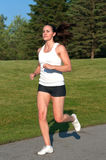 Fit young woman jogging Stock Images