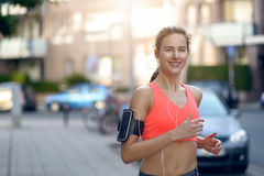 Fit young woman jogging along an urban street Royalty Free Stock Image